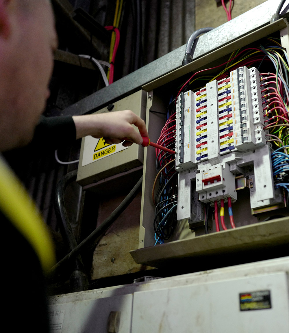 Man working on a fuse box